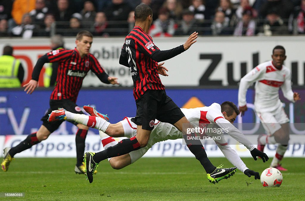 Frankfurt's Brazilian defender Bamba Anderson (C front) and Stuttgart's Bosnian striker Vedad Ibisevic (C back) vie for the ball during the German first division Bundesliga football match Eintracht Frankfurt vs VfB Stuttgart in Frankfurt am Main, western Germany, on March 17, 2013.
