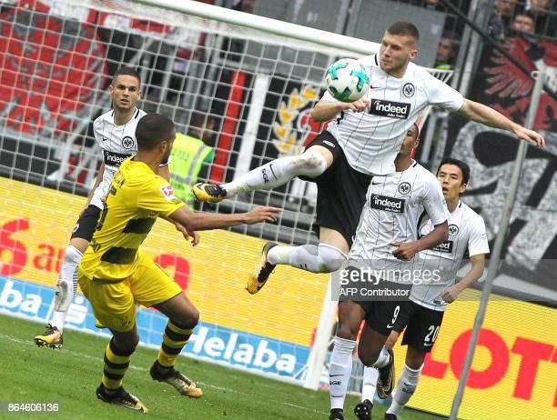 Frankfurt's Croatian forward Ante Rebic vies with Dortmund's German defender Jeremy Toljan during the German First division Bundesliga football match...