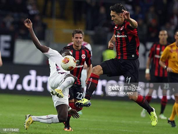 Frankfurt's Croatian forward Srdjan Lakic vies with Bordeaux's Malian midfielder Abdou Traore during Europa league football match between Eintracht...