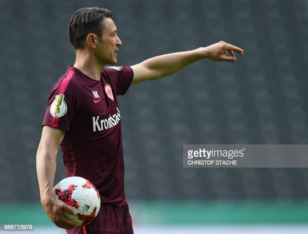 Frankfurt's Croatian headcoach Niko Kovac oversees a training session on the eve of the German Cup football final match between Eintracht Frankfurt...