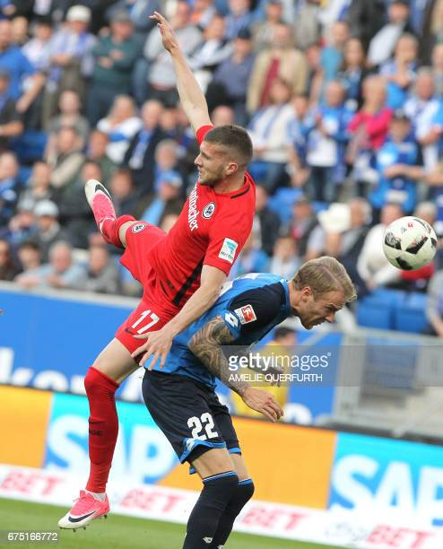 Frankfurt's Croatian striker Ante Rebic and Hoffenheim's midfielder Kevin Vogt vie for the ball during the German first division Bundesliga football...