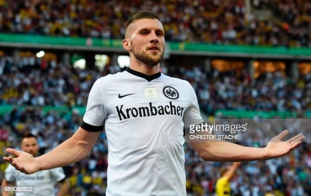 Frankfurt's Croatian striker Ante Rebic celebrates after scoring Frankfurt's first goal during the German Cup final football match Eintracht...