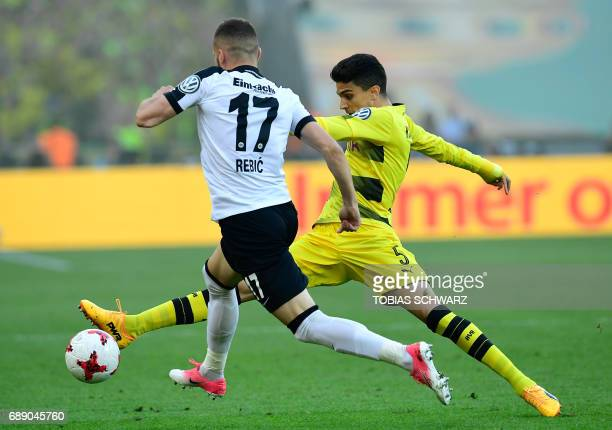 Frankfurt's Croatian striker Ante Rebic vies for the ball with Dortmund's Spanish defender Marc Bartra during the German Cup final football match...