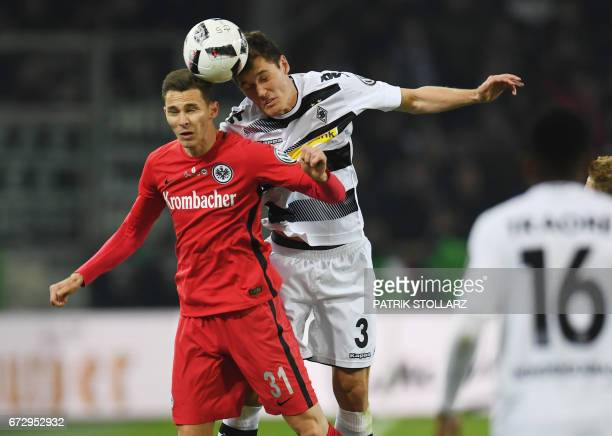 Frankfurt's defender Bastian Oczipka and Moenchengladbach's Danish defender Andreas Christensen vie for the ball during the German Cup DFB Pokal...
