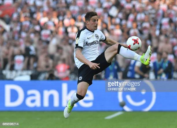 Frankfurt's defender Bastian Oczipka plays the ball during the German Cup final football match Eintracht Frankfurt v BVB Borussia Dortmund at the...