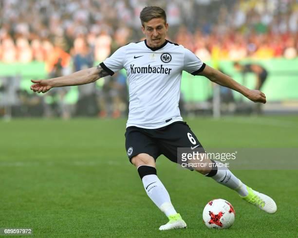 Frankfurt's defender Bastian Oczipka plays the ballduring the German Cup final football match Eintracht Frankfurt v BVB Borussia Dortmund at the...