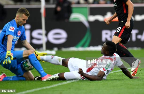 Frankfurt's Finnish goalkeeper Lukas Hradecky and Cologne's Colombian forward Jhon Cordoba vie for the ball during the German first division...