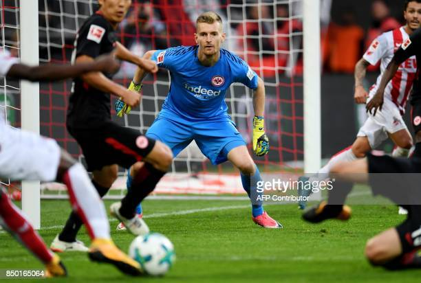 Frankfurt's Finnish goalkeeper Lukas Hradecky eyes the ball during the German First division Bundesliga football match 1FC Cologne vs Eintracht...
