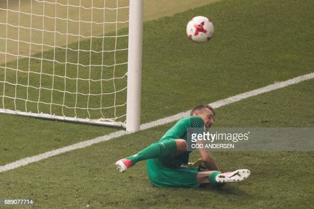 Frankfurt's Finnish goalkeeper Lukas Hradecky fails to save a penalty during the German Cup final football match Eintracht Frankfurt v BVB Borussia...