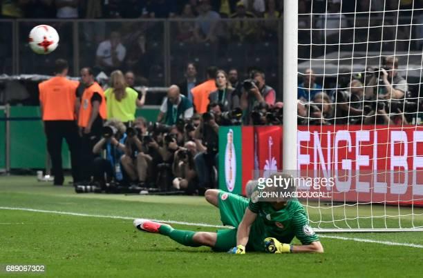 Frankfurt's Finnish goalkeeper Lukas Hradecky fails to save the penalty shoot during the German Cup final football match Eintracht Frankfurt v BVB...