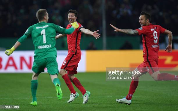 CORRECTION Frankfurt's Finnish goalkeeper Lukas Hradecky Frankfurt's Argentinian defender David Abraham and Frankfurt's Swiss striker Haris Seferovic...