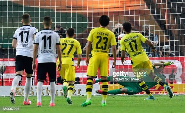 Frankfurt's Finnish goalkeeper Lukas Hradecky misses a penalty shot from Dortmund's Gabonese forward PierreEmerick Aubameyang during the German Cup...