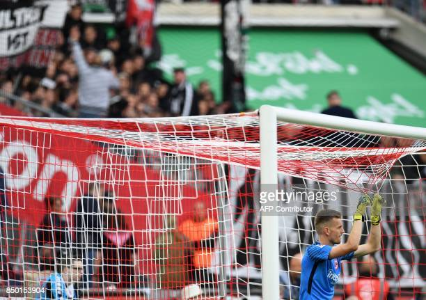 Frankfurt's Finnish goalkeeper Lukas Hradecky pulls the goal net during the German first division Bundesliga football match 1 FC Cologne v Eintracht...