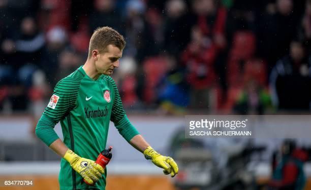 Frankfurt's Finnish goalkeeper Lukas Hradecky walks on the pitch during the German First division Bundesliga football match between Bayer Leverkusen...