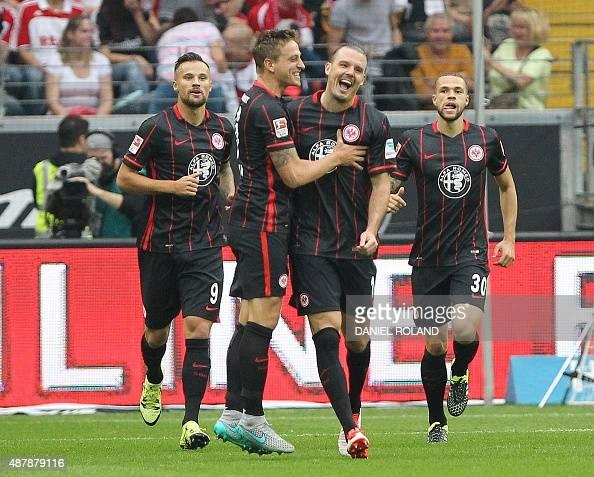 Frankfurt's forward Alexander Meier celebrates with team mates after scoring during the German first division Bundesliga football match Eintracht...