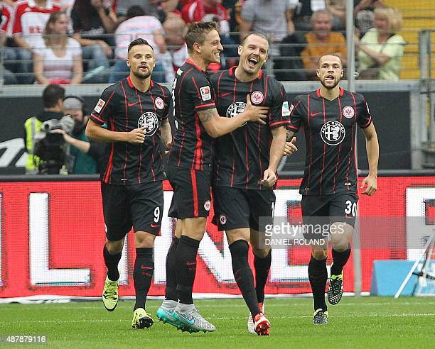 Frankfurt's forward Alexander Meier celebrates with team mates after scoring during the German first division Bundesliga football match Eintracht...