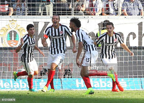 Frankfurt's Frankfurt's Jamaican defender Michael Hector celebrates scoring the 33 during the German first division Bundesliga football match between...