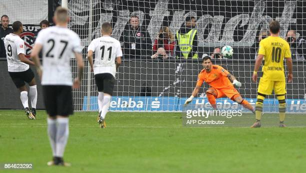 Frankfurt's French forward Sebastien Haller scores his team's second goal during the German First division Bundesliga football match Eintracht...