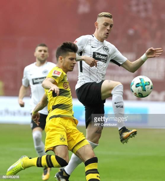Frankfurt's German midfielder Marius Wolf and Dortmund's German midfielder Julian Weigl vie for the ball during the German First division Bundesliga...