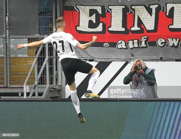 Frankfurt's German midfielder Marius Wolf celebrates after scoring a goal during the German First division Bundesliga football match Eintracht...