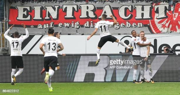 Frankfurt's German midfielder Marius Wolf celebrates with teammates after scoring a goal during the German First division Bundesliga football match...