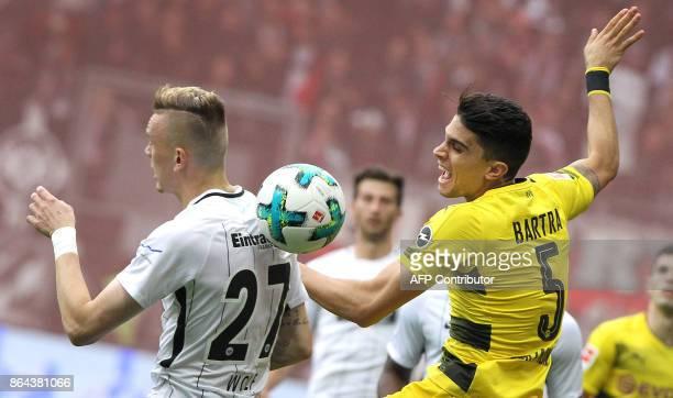 Frankfurt's German midfielder Marius Wolf vies with Dortmund's Marc Bartra during the German First division Bundesliga football match Eintracht...
