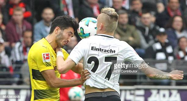Frankfurt's German midfielder Marius Wolf vies with Dortmund's Turkish midfielder Nuri Sahin during the German First division Bundesliga football...