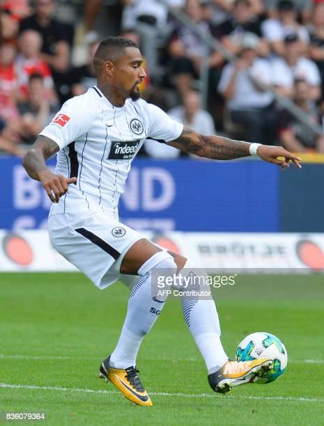 Frankfurt's Ghanaian midfielder KevinPrince Boateng controls the ball during the German First division Bundesliga football match SC Freiburg v...