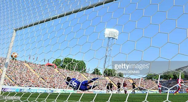 Frankfurt's goalkeeper Desirée Schumann dives for a ball as Lyon scores during the UEFA Women's Champions League final football match of Olympique...