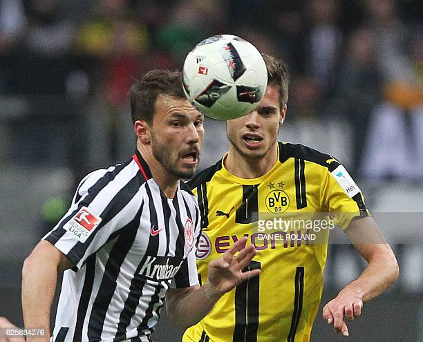 Frankfurt's Hungarian midfielder Szabolcs Huszti and Dortmund's midfielder Julian Weigl vie for the ball during the German first division Bundesliga...