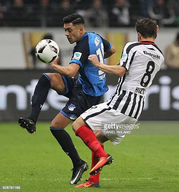 Frankfurt's Hungarian midfielder Szabolcs Huszti and Hoffenheim's midfielder Nadiem Amiri vie for the ball during the German first division...
