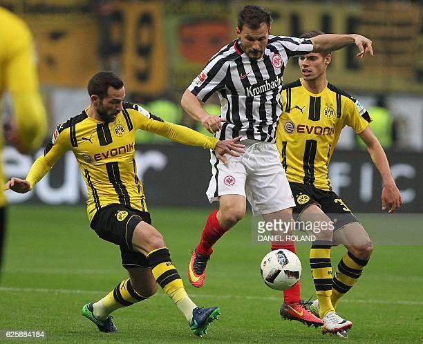 Frankfurt's Hungarian midfielder Szabolcs Huszti vies with Dortmund's midfielder Gonzalo Castro and Dortmund's midfielder Julian Weigl during the...