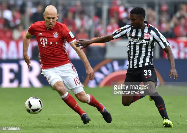 Frankfurt's Israeli defender Taleb Tawatha and Bayern Munich's Dutch midfielder Arjen Robben vie for the ball during the German First division...