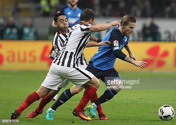 Frankfurt's Mexican midfielder Marco Fabian and Frankfurt's Hungarian midfielder Szabolcs Huszti vie for the ball with Hoffenheim's Polish midfielder...