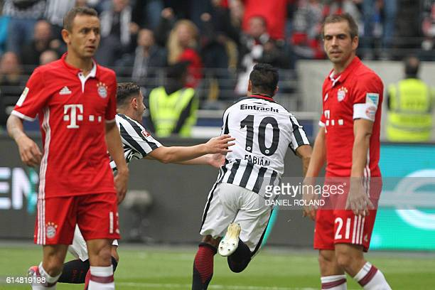 Frankfurt's Mexican midfielder Marco Fabian celebrates scoring the 22 during the German first division Bundesliga football match between Eintracht...