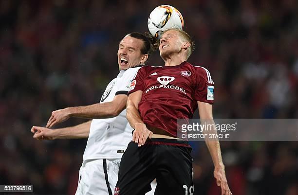 Frankfurt's midfielder Alexander Meier and Nuremberg's midfielder Hanno Behrens vie for the ball during the German Bundesliga secondleg relegation...