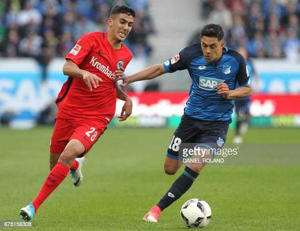 Frankfurt's midfielder Aymen Barkok and Hoffenheim's midfielder Nadiem Amiri vie for the ball during the German first division Bundesliga football...
