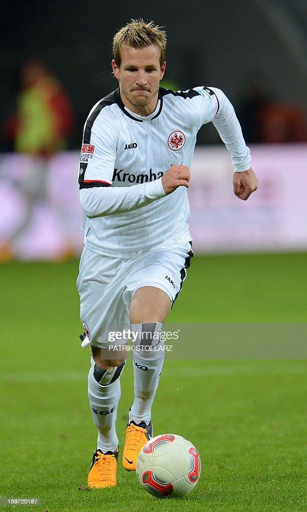 Frankfurt's midfielder Stefan Aigner vie for the ball during the German first division Bundesliga football match Bayer Leverkusen vs Eintracht Frankfurt in the German city of Leverkusen on January 19, 2013.