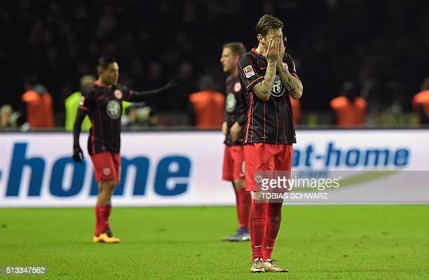 Frankfurt's players react after the German first division Bundesliga football match of Hertha Berlin BSC v Eintracht Frankfurt in Berlin on March 2...