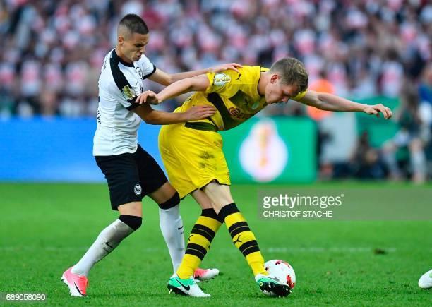 Frankfurt's Serbian midfielder Mijat Gacinovic and Dortmund's defender Matthias Ginter vie for the ball during the German Cup final football match...