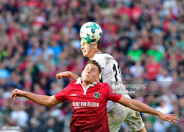 Frankfurt's Serbian midfielder Mijat Gacinovic and Hanover's German defender Waldemar Anton vie for the ball during the German First division...