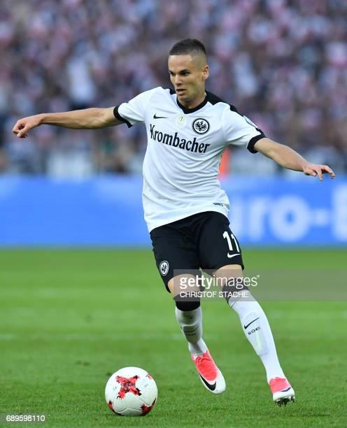 Frankfurt's Serbian midfielder Mijat Gacinovic plays the ball during the German Cup final football match Eintracht Frankfurt v BVB Borussia Dortmund...