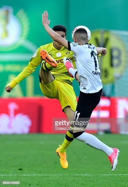 Frankfurt's Serbian midfielder Mijat Gacinovic vies for the ball with Dortmund's Spanish defender Marc Bartra during the German Cup final football...