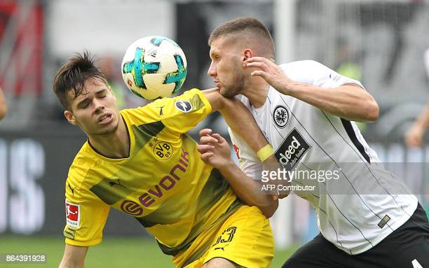 Frankfurt's Serbian midfielder Mijat Gacinovic vies with Dortmund's German midfielder Julian Weigl during the German First division Bundesliga...