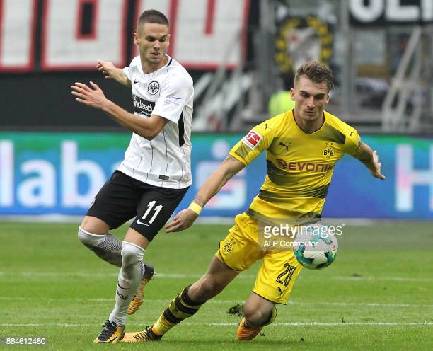 Frankfurt's Serbian midfielder Mijat Gacinovic vies with Dortmund's German forward Maximilian Philipp during the German First division Bundesliga...