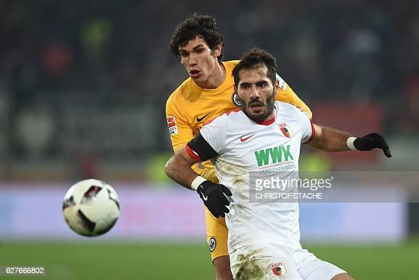 Frankfurt's Spanish defender Jesus Vallejo and Augsburg's Turkish midfielder Halil Altintop vie for the ball during the German first division...