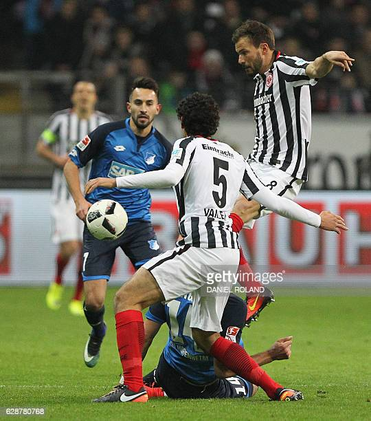Frankfurt's Spanish defender Jesus Vallejo and Frankfurt's Hungarian midfielder Szabolcs Huszti vie for the ball with Frankfurt's forward Danny Blum...