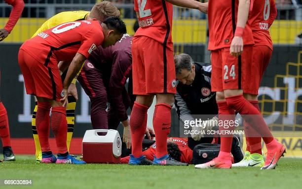 Frankfurt's Spanish defender Jesus Vallejo gets medical assistance after injury during the German First division Bundesliga football match between...