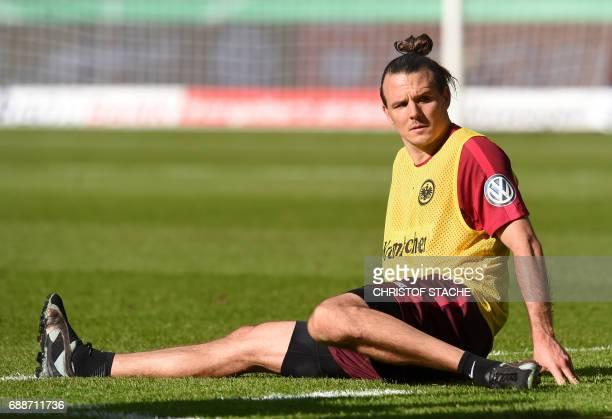 Frankfurt's striker Alexander Meier stretches during a training session on the eve of the German Cup football final match between Eintracht Frankfurt...
