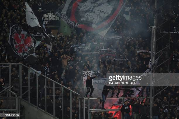 TOPSHOT Frankfurt's supporters react after penalty shoot out during the German Cup DFB Pokal semifinal football match between Borussia...